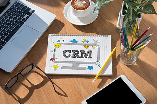 CRM  Business Customer CRM Management Analysis Service Concept  open book on table and coffee Business