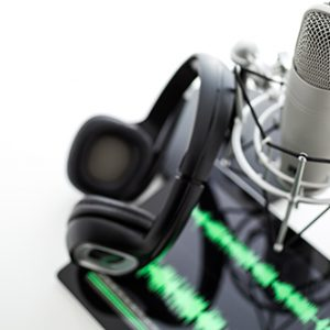 Studio microphone for recording podcasts with headset on a white background.
